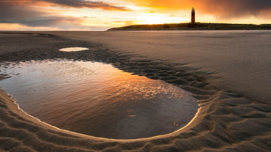 Sunrise at Lighthouse Texel Beach